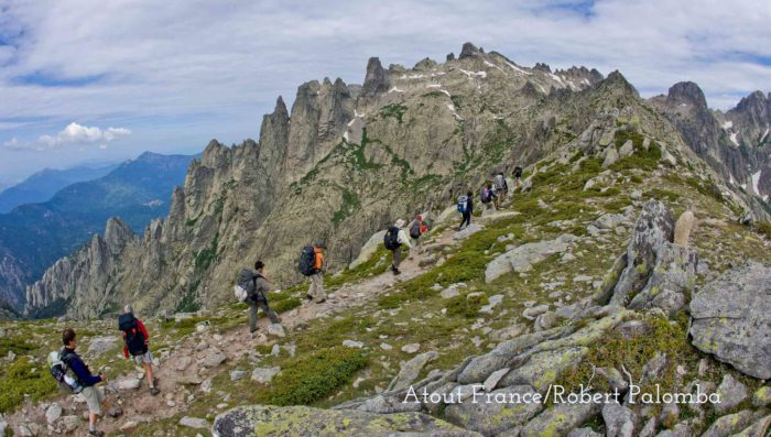 group od hikers in mountains above restonica gorge corsica